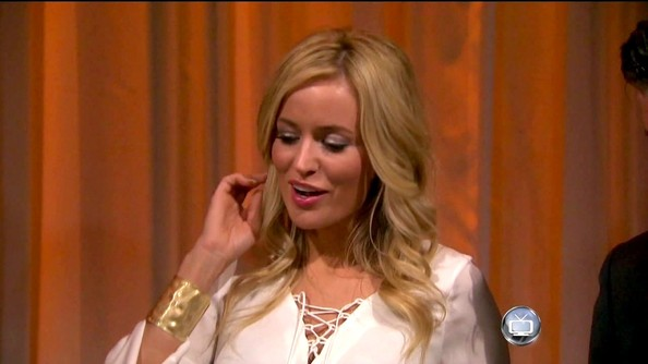 Emily Maynard gave her lace-up blouse a Wonder Woman feel with a gold hammered metal cuff.
