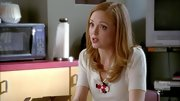 Jayma Mays' classic knit top was brought to life with a red, white and blue flower brooch.