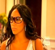 Melissa Gorga kept her shades on indoors, opting for a reflective wrap-around pair.