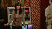 While rocking out to her song on the juke box, Jessica Day wore a Boden sweater boasting a novel Yorkshire Terrier striped pattern.