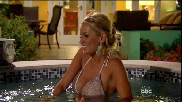 Emily Maynard went for a dip back at the Fantasy Suite in a printed tan string bikini.