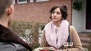 Katie Findlay looked sophisticated and polished in a baby pink scarf for Thanksgiving dinner on 'The Carrie Diaries.'