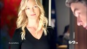 Kari Matchett streamlined her figure with a flattering black v-neck sweater on 'Covert Affairs.'