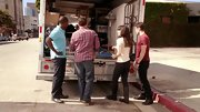 Forget the ballet flats. For moving day, Zooey Deschanel pitched in with a pair of chocolate leather riding boots.