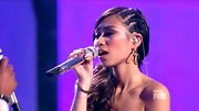 Jessica Sanchez gave her feminine dress a subtle edge with unexpected cornrows in her side-swept ponytail.