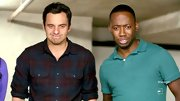 Jake Johnson showed his casual side with a red and blue plaid shirt on 'New Girl.'