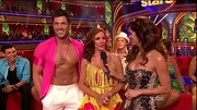 Maksim Chmerkovskiy's open neon pink shirt ensured no eyes drifted away from his rock hard abs.