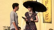 Michelle Trachtenberg shielded her porcelain skin, but not her summery dotted dress, with a black parasol.
