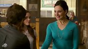 Madeleine Stowe's turquoise v-neck sweater popped against her olive complexion.
