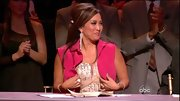 Carrie Ann Inaba dressed down her bedazzled gown with a puzzling hot pink vest during the 'DWTS' finale.