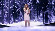 Hollie Cavanagh matched her wardrobe to the snowy stage setting in this sparkling white cocktail dress.