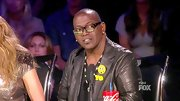 Never one to take his fashion sense too seriously, Randy Jackson livened up his black leather jacket with bright yellow smiley face and Yo pins.