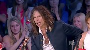Steven Tyler's unbuttoned button-up shirt revealed a unique beaded lariat necklace. The man loves his accessories!