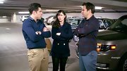 Max Greenfield showed his preppy side with a navy crew neck sweater paired over a button down top.