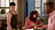 Zooey Deschanel chose a brown-and-pink striped sweater for a cute but casual look on 'New Girl.'