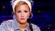 Demi Lovato puckered up on 'X Factor' with hot pink lipstick.