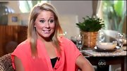 Shawn Johnson complemented her peaches and cream complexion with an oversize coral blouse.