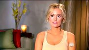 For a relaxed look, Emily Maynard sweeps her curls up into a bun, leaving several tendrils loose around her face.