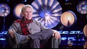 Gary Busey was interviewed for Dancing With The Stars while wearing a classic red and black plaid scarf.