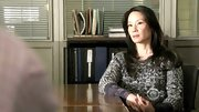 Lucy Liu kept warm on 'Elementary' in a thick cable knit sweater layered over a patterned T-shirt.