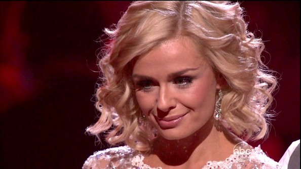 Ever the lady, Katherine Jenkins accessorized her demure lace dress with dangling pearl earrings.