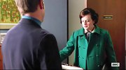Elisabeth Moss chose a classic emerald green wool coat while on 'Mad Men.'