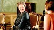Let's all agree that Maggie Smith wears the heck out of lavish period gowns.