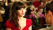 To match the romantic vibe of her red sweetheart dress, Zooey Deschanel wore her banged 'do in slightly messy ringlets.