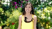 Jessica Sanchez added drama to her yellow day dress with extra long feathered earrings.
