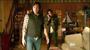 Nick Wechsler kept things rugged by layering a black utility vest over his plaid button-down.