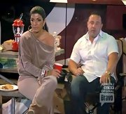 Teresa Giudice kicked back on 'The Real Houswives' in what appears to be an off-the-shoulder velour sweatshirt.