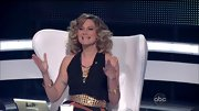 A gold nail-studded belt gave Jennifer Nettles' black jumpsuit disco flavor.