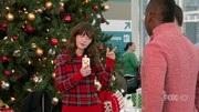 Jess looked festive in a red plaid sweater during her airport adventure during the holidays.