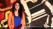 Sylvia Yacoub color-blocked a vibrant orange blazer with a royal blue top on 'The Voice.'