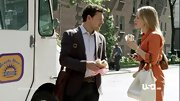 Piper Perabo punctuated an orange dress with a chic white tote on 'Covert Affairs.'