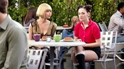 Zooey's red polo and knee-high socks made for a quirky flashback ensemble.