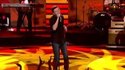 "Scotty McCreery kept things classic on the ""American Idol' stage, pairing his bootcut jeans with a blue button-down shirt."