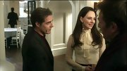 Madeleine Stowe kept covered up in an elegant pin-dotted chiffon blouse with a '60s style tie-neck.