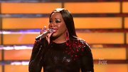 Fantasia Barrino styled her 'American Idol' season finale look with a pair of red dangle earrings.