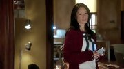 Forget hooded sweatshirts and old bathrobes. When Lucy Liu relaxed at home on 'Elementary,' she relies on cozy, yet cute layers like this red cardigan.