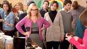 Rachael Harris brightened up a basic gray sheath with this berry cardigan.