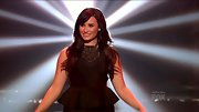 Demi Lovato embraced her curves on 'The X Factor' in this flattering peplum dress.