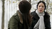 Lucy Liu warmed up on 'Elementary' in a securely tied gray scarf.