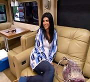 What does one wear on a cross country road trip in an RV? Well, if you're Teresa Giudice, you stay cozy and chic in a long Aztec print cardigan.