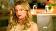 Emily VanCamp wears her honey blond tresses in loose face framing curls.