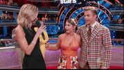 Bindi Irwin hit the dance floor on DWTS in this sequined orange halter.