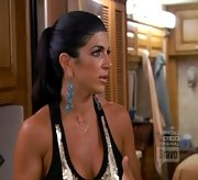 Teresa Giudice added drama to her tank with a pair of glitzy blue dangle earrings.