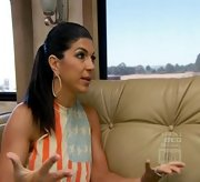 Teresa Giudice added drama to a casual tank with chunky gold hoops.