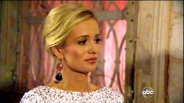 Emily Maynard's chic chignon revealed dangling coral and onyx earrings.