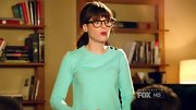 Zooey Deschanel continued to embrace the mint fad with this buttoned crewneck sweater.